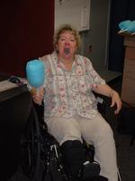 Mom enjoys the cotton candy, even with a broken foot.