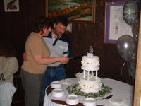 CJ & Sally cutting the cake