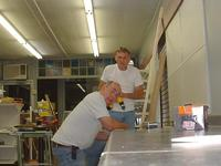 Bunky & Dad building the counters, 5/31/02