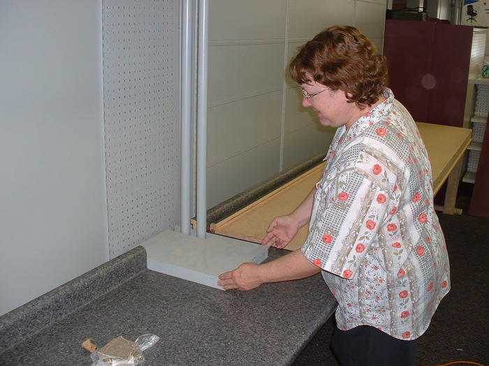 Mom inspects the woodwork, 6-9-02
