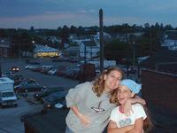 6-15-02, Heather & Ashlyn on the roof, Henicle's in the background