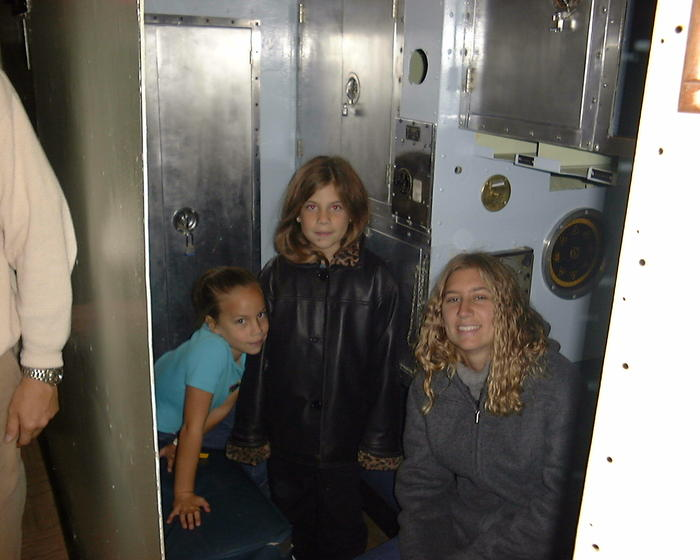 Heather and her sisters in the submarine