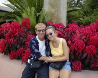 Glenn & Christina by flowers in Epcot
