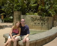 Mike & Heather next to Rainforest Cafe sign