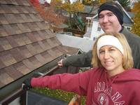 Mike & Heather putting clips on the gutters.