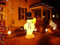 Our 8' tall snowman, guarding the house.