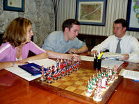 Heather, Mike, and Attorney Clint siging at closing, June 1st, 2004.