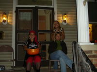 Heather and her sisters handing out candy