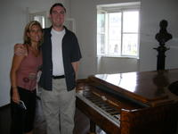Heather & Mike by a piano that Beethoven played